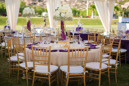 Tent, chairs, and table linens at outdoor wedding